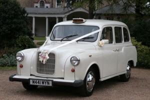 white-london-taxi