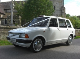 White classic Taxi for wedding hire in East Grinstead