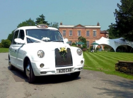 Classic White Taxi for weddings in Stockport