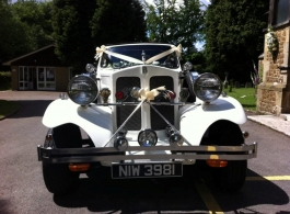 White vintage wedding car in Petersfield