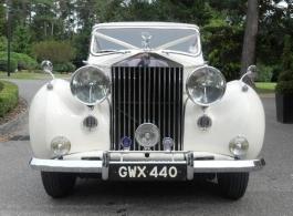 Cream Vintage Rolls Royce wedding car in Epsom