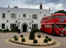 Red double deck bus for weddings in Oxford