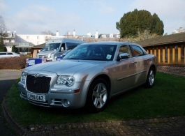 Silver Chrysler 300c for weddings in Worthing