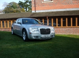 Silver Chrysler saloon for weddings in Goodwood