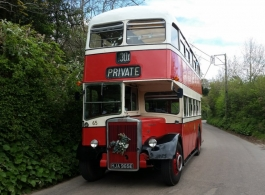 Red double deck bus for weddings in Minehead